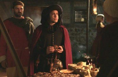 Mittelalterlicher Händler am Lebkuchenstand (Standbild aus Imagefilm)